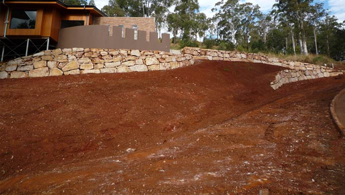 Earthworks and land clearing by classic rock walls