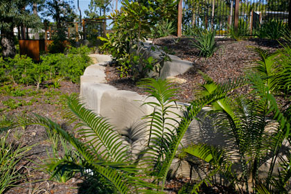 Sculptured garden with  retaining wall made from sized sandstone